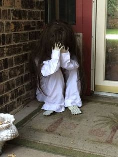 crying scary child sitting on your front porch will frighten trick or treaters