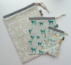 Child #2 will be off to an art camp in just a few days, so I decided to whip up these super simple, but so very useful drawstring bags for her. Can you tell we're totally into cats these days?  I used