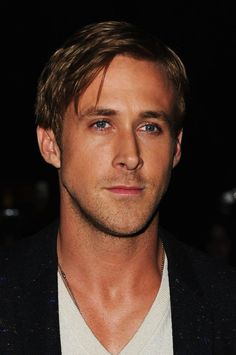 Ryan Gosling tanned and casually glamorous.