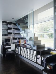 Staircase that combines desk, storage and stairs all in one.