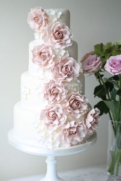 Cascading Roses Four-Layer Wedding Cake - Check out 14 Fabulous Wedding Cakes with Modern Flair!