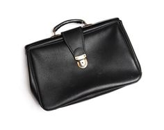 Vintage leather briefcase, structured black doctor's satchel bag with silver colored clasp and top handle, 1960s by Aerosvar