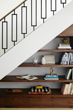 Amazing metal stair rail and storage under the stairs