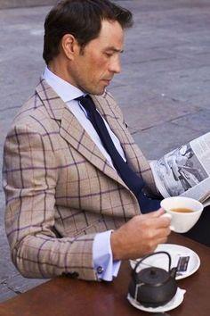 Men's Grey Blazer, Blue Dress Shirt, Navy Tie, Brown Leather Belt, Blue Jeans, and Navy Polka Dot Cotton Pocket Square | Lookastic for Men
