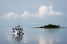 people fishing - People fish with an island in the background.