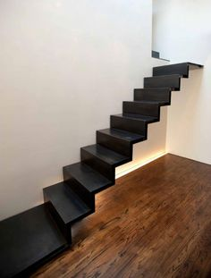 floating-stairs-cold-rolled-steel-raad.jpg (466×616)  Floating from one floor to another, these black cold-rolled steel stairs resemble one solid piece of metal, folded like an accordion. Designed by RAAD for a home in Manhattan, the stairs have several waterjet-cut steel stringers concealed within the thickness of the metal.