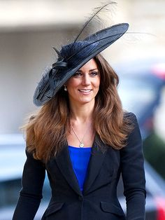 Kate Middleton wearing a Philip Somerville Aurora Picture Hat at the wedding of Prince William's friend, Harry Meade in 2010.