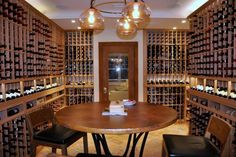 Custom Wine Cellars Long Island NY - The Final Look. See how the high reveal display row & horizontal display row add more style to the cellar. The wine tasting table  & the lighting system make this wine room much of an entertainment area. Check out more wine cellar designs by visiting our wine cellars gallery here http://www.winecellarsbycoastal.com/custom-wine-cellars.aspx. Coastal Custom Wine Cellars New Jersey  2405 Orchard Crest Ste B  Manasquan, NJ. 08736  +1 (732) 722-5466
