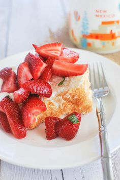 Lemon Angel Food Cake with Strawberries and Mint - light and fluffy cake with delicious strawberries on top!