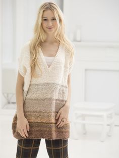 Style this V-neck poncho with your favorite t-shirt or buttoned collared shirt for a cozy, comfortable work outfit.