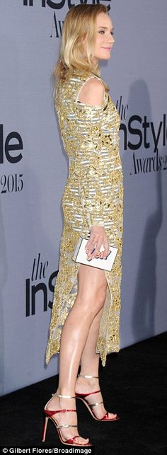 Fun footwear: The actress paired her metallic dress with red and gold stilettos...