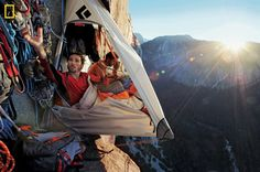 """(Photo by Jimmy Chin, National Geographic) Kevin Jorgeson (left) and Tommy Caldwell live in a """"portaledge"""" 1,500 feet above the valley for up to two weeks when working on a route. Amenities include a French press for coffee and iPhones charged with a solar panel."""