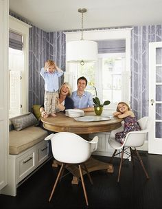 Cole  Son wallpaper with round wood table and eames chairs