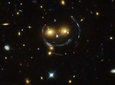 This photo taken of the galaxy cluster SDSS J1038+8949 by the Hubble Space Telescope appears to show... - NASA/ESA