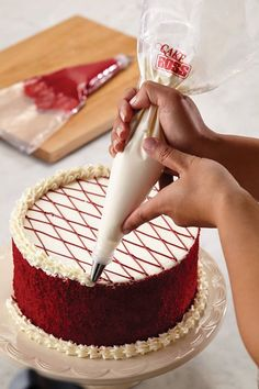 Dye the batter the color you want and then just frost the top and add a border to the bottom. Cool idea!