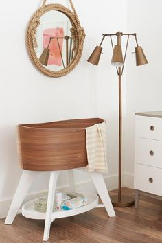 Our Norse Bassinet features walnut veneer, giving each one stunning, natural wood grain. And the sleek, oval shape of the Scandinavian-inspired design gives it a clean, modern look that'll allow it to fit anywhere in the home. Take a closer look, we swear you'll fall in love!