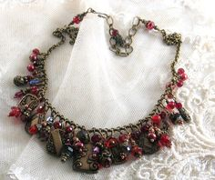Beautiful Button Top Glass Beaded Necklace by Laurie Langhorn....findings from B'sue Boutiques