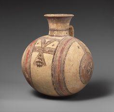 Terracotta barrel-shaped jug