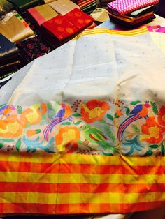 Off-white pure zari tissue kota with kadial weaving border and thread weaving design