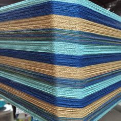 Can you imagine how great napkins would look when woven from this warp?  Our unique kits come with pre-wound warp; threading and raddle cross included. Bobbins of weft for 4 napkins. Great value.