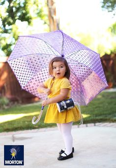 """Willow has become the Morton Salt Girl... Last year photographer Gina Lee and her daughter, Willow, declared October """"Dress Up Willow Month"""" to celebrate Halloween."""