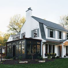 Kenowa Builders Modern Farmhouse Exterior, White House Remodel Dutch Colonial Front Porch, house exterior ideas with sunroom addition, Grand Rapids remodeling