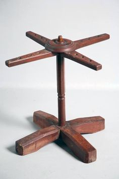 "OHIO CANDLE DRYING STAND.  Maple and ash with the original red wash. ""X"" base and arms and turned and paneled post. Nicely detailed with chamfered edges and ring turned cap. Some later nails added underneath. 20""h."