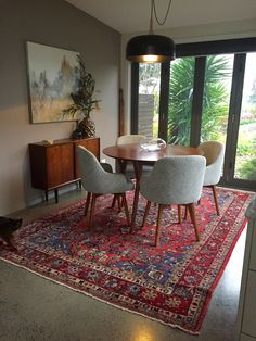 Warm up polished concrete floors with beautiful antique Persian rugs