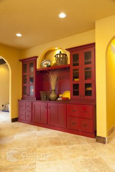 Hi contrast yellow and red. Pops. Knotty Alder | Valley Forge Door - mediterranean - kitchen - wichita - Custom Cupboards