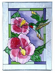 """Ruby Throated HUMMINGBIRD Window 10.25 x 14 HIBISCUS Stained Glass Suncatcher by eEarthExchange. $59.95. Matching and complementary stained glass windows are also offered. **  ** SHIPS UPS - Order BY DECEMBER 13 for CHRISTMAS DELIVERY **  **. 10.25"""" x 14"""" SUNCATCHER. Proudly Made in the USA, ships via UPS Ground with insurance.. Comes with hooks and chain for immediate placement. Like no other product, art glass delivers high visual impact! The rich, vibrant look of stained gl..."""