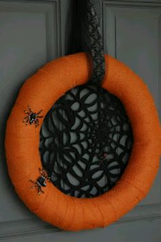 Halloween wreat with orange burlap, web placemat, and plastic spiders