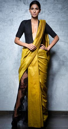 Yellow silk and flocked net half and half sari with a black linen body suit blouse by NIKHIL THAMPI