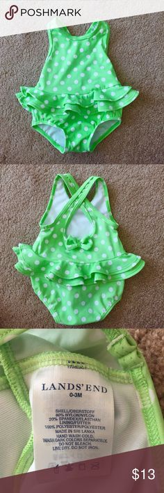 🎉HP🎉 0-3m Ruffle Bathing Suit Adorable Land's End lime green polkadot bathing suit with ruffle trim. The straps crisscross in the back with a little bow for extra cuteness! Washed and worn a couple times and in excellent condition! Size 0-3 months. Make an offer! Bundle 2 or more items and save 10% plus combined shipping! Land's End Swim