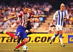 Real Sociedad 1 At Madrid 2 in Sept 2013 at Anoeta Stadio. Antoine Griezmann takes it up with Mario Suarez looking on in La Liga.
