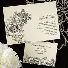 This 100% cotton, ecru invitation card details a black floral design pressed into the card..