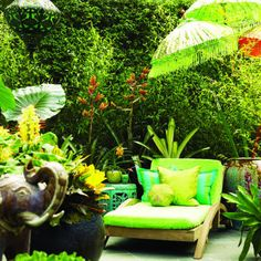 """Tropical glam    A comfy lounge chair big sits amid tropical splendor in this jungle-inspired California garden.    A patio needs places """"where the eye can stop, rest, and be delighted,"""" landscape designer Davis Dalbok says.     More about his patio"""