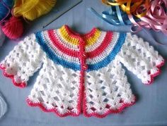 1-tığ işi renkli bebek hırkası (1)
