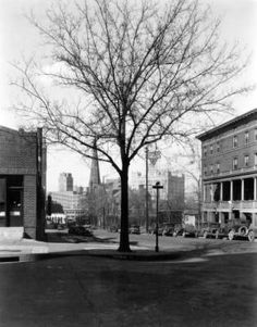 View, from 18th (Eighteenth) Avenue and Sherman Street, of buildings in downtown Denver, Colorado. The Y. W. C. A. is nearby on 18th Avenue. Trinity Methodist Church and the Continental Oil Company (Conoco) Building are in the distance. Date[between 1920 and 1930?]. :: Western History