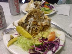 This is the best lamb doner kebab from a kebab shop that I've ever had. The pitta was thin and grilled to perfection. The doner meat was thinly shaved, succulent, not oily and tasted superb. Kebab Sauce, Turkish Recipes, Ethnic Recipes, Yogurt Sauce, Pitta, Skewers, Ground Beef, Lamb, Grilling