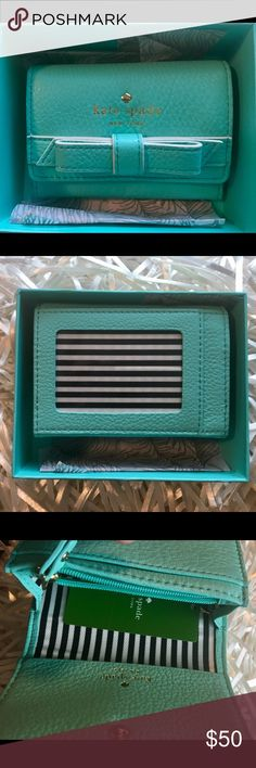 Kate Spade Christine Street Wallet Kate Spade Christine Street leather wallet with bow and key ring holder  The color of this small wallet is to die for!! It's almost Tiffany blue  hurry dolls, or I might just keep it for myself!!  kate spade Accessories