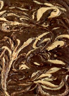 Peanut Butter Swirl Black Bean Brownies   nourishedtheblog.com   This recipe for Black Bean Brownies is made gluten free with black beans instead of flour and are beautifully swirled with natural peanut butter.