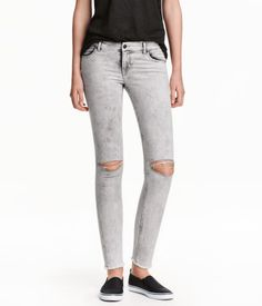 Black/Acid. Low-rise jeans in washed stretch denim with heavily distressed…