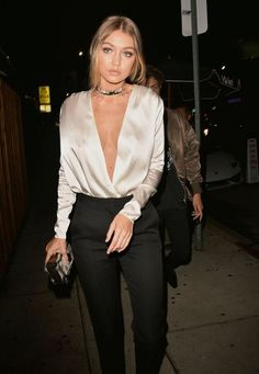 Gigi Hadid in a nude satin top, black choker, and slacks - celebrity street style
