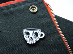 Death before decaf  The perfect pin for a coffee shop punk. Saft enamel pin stamped in black zinc. Pin has black rubber backing. Design is limited to