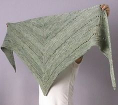 This top down shawl uses two strands of a 4ply yarn to create texture. Reverse stocking stitch, is matched with stocking stitch where stitches are knitted into the back, to give them a raised appearance. Lace eyelets define sections.