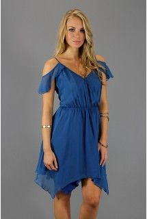 6 Shore Road: Blue Captain's Wrap Mini Dress   - Available at www.shop312.com -   This blue chiffon wrap dress by 6 Shore Road has a crossover V-neckline, dropped ruffle shoulder and elastic waistband. Adjustable spaghetti straps.