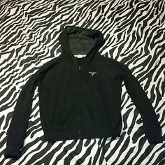 Pink VS.pink hoodie Black with sliver foil front dog logo and love pink sliver foil on back. Also has air vent holes under the armpits..in great condition. Will admit has been worn 4 maybe 5 times and washed. So the washings just began a lil crackling in fiol but cant even tell to be honest. Zebra print on the inside of the hood.at the lowest. PINK Victoria's Secret Sweaters