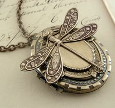 Dragonfly Locket Necklace in Vintage Brass, $45.00 from chloesvintagejewelry on Etsy -- LOVE.