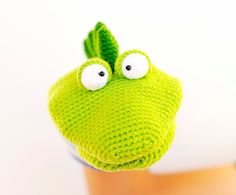 DINO the HAND PUPPET crochet pattern  This pattern is just a click to download and made to print on regular home printers, A4 size paper.  Finished size of the toy is 9.06″ / 23 cm x 4.07″ / 12 cm, using 100% 8 ply cotton yarn and 3 mm / US C / UK 11 hook size. All measurements are approximate and can vary depending on tension and yarn choice.  Skills you need: Skills required include chain st, single crochet st, slip st, back loop only, increases, decreases (US crochet t...