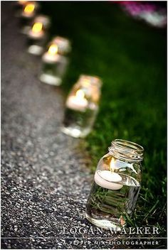 Mason jars with floating candles line the pathway to the backyard reception. - - Mason jars with floating candles line the pathway to the backyard reception. Mason jars with floating candles line the pathway to the backyard reception. Diy Wedding, Rustic Wedding, Dream Wedding, Trendy Wedding, Wedding Church, Wedding Ceremony, Party Wedding, Simple Wedding Reception, Wedding Tables